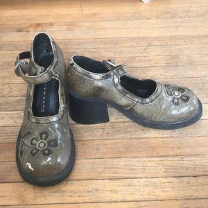 Unique heels.  Worn in front